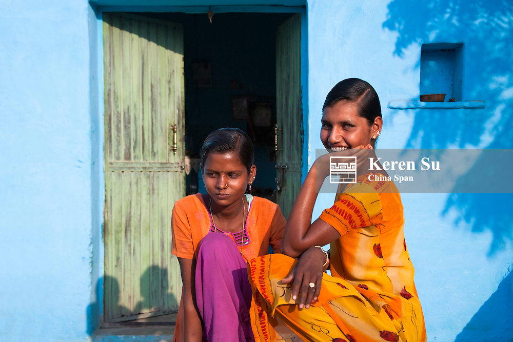 Indian people in blue painted house