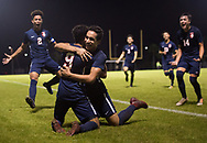 St. Lucie West Centennial's Carlos Rodriguez (center) congratulates teammate Rian Jamai after scoring the game-winning goal with two minutes left against Jupiter during the high school boys soccer District 10-5A championship Friday, Feb. 2, 2019, at South County Regional Stadium in Port St. Lucie. Centennial's Norland Rivera (left) and Nico Guerrero (right) run in for a dog pile.