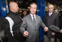 © Licensed to London News Pictures . 21/11/2014 . Kent , UK . UKIP leader NIGEL FARAGE in front of the UKIP shop in Rochester this morning (Friday 21st November 2014) following Mark Reckless' win for the party in the Rochester and Strood by-election . Photo credit : Joel Goodman/LNP