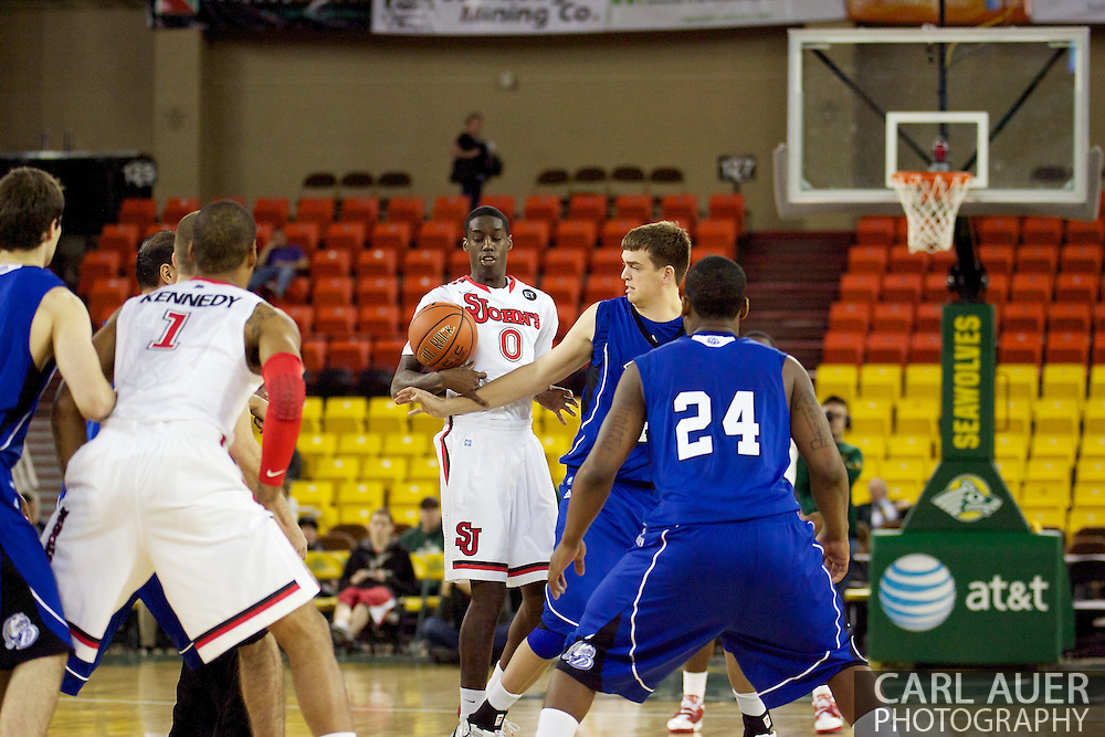 November 26th, 2010:  Anchorage, Alaska - St. John's freshman forward Dwayne Polee has a loose ball hit him in the chest during the Red Storm's Great Alaska Shootout game against the Drake Bulldogs.  .The Red Storm defense held Drake to a tournament low score as St. Johns advanced to the final game 82-39.