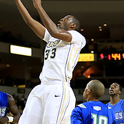 Keith Clanton (33) of the University of Central Florida Knights mens basketball team dribbles the ball past Mike Lewis (10) of the West Florida Argonauts in the first home game of the 2010 season at the UCF Arena on November 12, 2010 in Orlando, Florida. UCF won the game 115-61. (AP Photo/Alex Menendez)