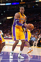 30 October 2012: Center (12) Dwight Howard of the Los Angeles Lakers grabs a rebound against the Dallas Mavericks during the first half of the Mavericks 99-91 victory over the Lakers at the STAPLES Center in Los Angeles, CA.