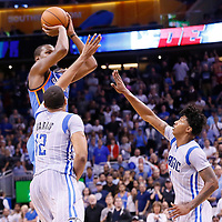 30 October 2015: Oklahoma City Thunder forward Kevin Durant (35) takes a jump shot over Orlando Magic forward Tobias Harris (12) and Orlando Magic guard Elfrid Payton (4) during the Oklahoma City Thunder 139-136 double overtime victory over the Orlando Magic, at the Amway Center, in Orlando, Florida, USA.