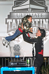 February 23, 2019 - Hampton, GA, U.S. - HAMPTON, GA - FEBRUARY 23:   Kyle Busch tosses his son Brexton up in the air in Victory Circle after winning the 11th running of the Ultimate Tailgating 200 NASCAR Gander Outdoors Truck Series race on February 23, 2019 at the Atlanta Motor Speedway in Hampton, GA.  (Photo by David J. Griffin/Icon Sportswire) (Credit Image: © David J. Griffin/Icon SMI via ZUMA Press)