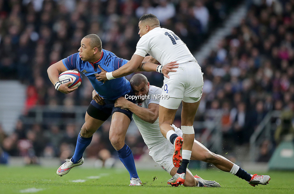 RBS 6 Nations Championship, Twickenham Stadium, London, England 21/3/2015<br /> England vs France<br /> England's Anthony Watson and Jonathan Joseph with Ga&euml;l Fickou of France<br /> Mandatory Credit &copy;INPHO/Morgan Treacy