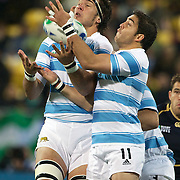 Patrico Albacete, Argentina, (left) and his team mate Horacio Agulla, (right) challenge for the ball during the Argentina V Scotland, Pool B match at the IRB Rugby World Cup tournament. Wellington Regional Stadium, Wellington, New Zealand, 25th September 2011. Photo Tim Clayton...