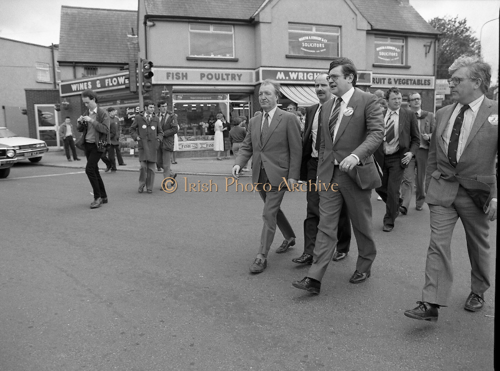 Taoiseach's Election Campaign.      (N77)..1981..23.05.1981..05.23.1981..23rd May 1981..On the 21st May the Taoiseach, Mr Charles Haughey, dissolved the Dáil and called a general election. Charles Haughey, Garret Fitzgerald and Frank Cluskey were leading their respective parties into a general election for the first time as they had only taken party leadership during the last Dáil..Fianna Fáil had hoped to call the election earlier, but the Stardust Tragedy caused the decision to be deferred...Crossing Main Street, Malahide, Ray Burke is pictured leading his party leader,Charles Haughey to meet potential party voters.
