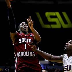 Jan 16, 2013; Baton Rouge, LA, USA; South Carolina Gamecocks guard Brenton Williams (1) shoots over LSU Tigers forward Jalen Courtney (3) during the first half of a game at the Pete Maravich Assembly Center. Mandatory Credit: Derick E. Hingle-USA TODAY Sports