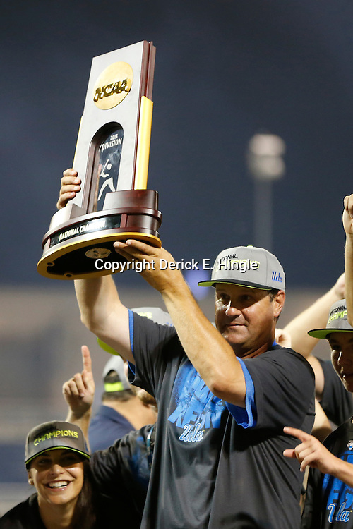 Jun 25, 2013; Omaha, NE, USA; UCLA Bruins head coach John Savage (22) hoists the championship trophy after game 2 of the College World Series finals against the Mississippi State Bulldogs at TD Ameritrade Park. UCLA defeated Mississippi State 8-0. Mandatory Credit: Derick E. Hingle-USA TODAY Sports