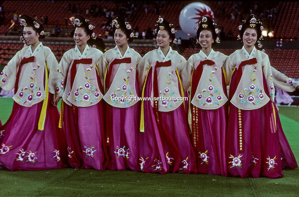 Seoul, South Korea --- A group of dancers in traditional costume pose at the Asian Games in Seoul, South Korea.