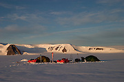 Evening camp during a British mountaineering expedition to Knud Rasmussens Land, East Greenland, Arctic, 2006.