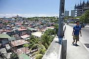 overlook of squatter homes mixed in with some owned houses in Taguig, Metro Manila.