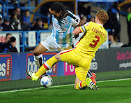 Sean Scannell of Huddersfield Town battles with Dean Lewington of Milton Keynes Dons during the Sky Bet Championship match at the John Smiths Stadium, Huddersfield<br /> Picture by Graham Crowther/Focus Images Ltd +44 7763 140036<br /> 20/10/2015