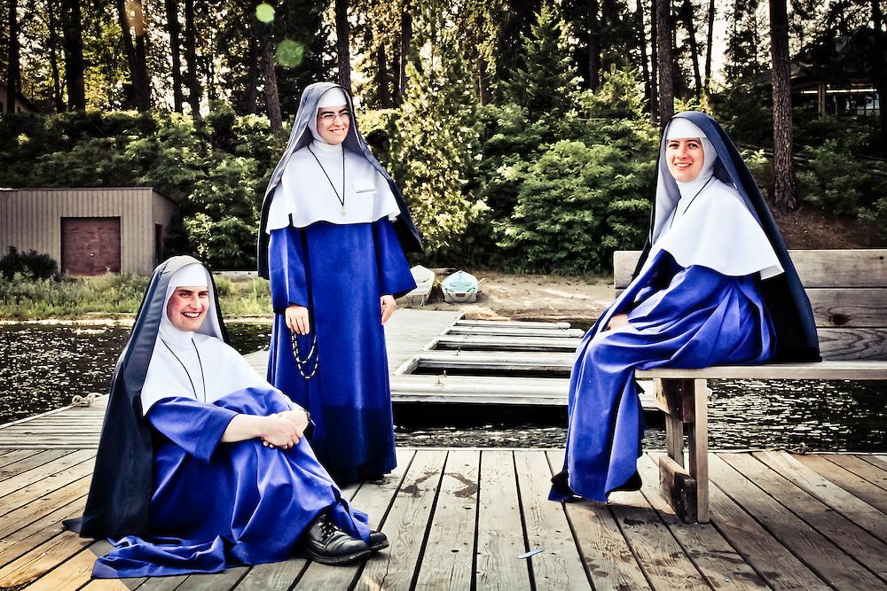 Three Nuns relax on a pier in deer lake, Eastern Washington.