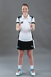 Umpire Julie Wilks signalling obstruction of player with ball
