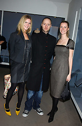 Left to right, EMILY LOBEL,  IAN GARLANT Creative Director of the Hardy Amies fashion house and CHLOE DELEVINGNE at a fashion show and after party to celebrate the 20th Anniversay of fashion designer Ozwald Boateng held at the Victoria & Albert Museum, London on 25th November 2005.<br /><br />NON EXCLUSIVE - WORLD RIGHTS