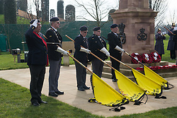 © Licensed to London News Pictures. 27/02/2016. <br /> <br /> Pictured: Veteran standard bearers of The Staffordshire Regimental Association lower their flags during the National Anthem at the Operation Granby Service at The National Memorial Arboretum on Saturday 27th February 2016.<br /> <br /> A service has been held at The National Memorial Arboretum on Saturday 27th February 2016 to commemorate The Stafford Regiments participation in Operation Granby, a British military operation held in 1991 during the first Gulf War in which soldiers helped liberate Kuwait from Iraqi occupation ordered by Saddam Hussain.    <br /> <br /> Two Staffordshire Regiment soldiers, Private Carl Moult and Private Shaun Taylor were killed in Operation Granby.<br /> <br />  Photo credit should read Max Bryan/LNP