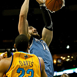 Jan 11, 2013; New Orleans, LA, USA; Minnesota Timberwolves center Nikola Pekovic (14) dunks over New Orleans Hornets power forward Anthony Davis (23) during  the first quarter of a game at the New Orleans Arena. Mandatory Credit: Derick E. Hingle-USA TODAY Sports