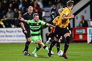 Forest Green Rovers Carl Winchester(7) passes the ball forward during the EFL Sky Bet League 2 match between Cambridge United and Forest Green Rovers at the Cambs Glass Stadium, Cambridge, England on 2 October 2018.