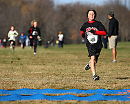 Ethan Fish, 8, of Marion, comes into the finish line area in the 1 mile run at the Muddy Monster Cross Country Run at Seminole Valley Park in Cedar Rapids on Saturday October 24, 2009. Over 500 people were registered for the event which featured a 5K run/walk, a 15K run, a 1 mile run for kids 17 and under, and a kids fun run. Proceeds from the event benefit The Achilles Heel Foundation.