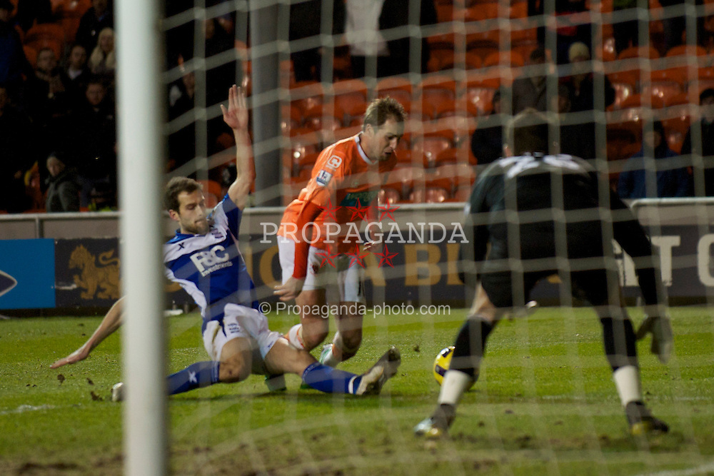 BLACKPOOL, ENGLAND - Tuesday, January 4, 2011: Blackpool's Luke Varney is brought down by Birmingham City's Roger Johnson but no penalty was given during the Premiership match at Bloomfield Road. (Pic by: David Rawcliffe/Propaganda)