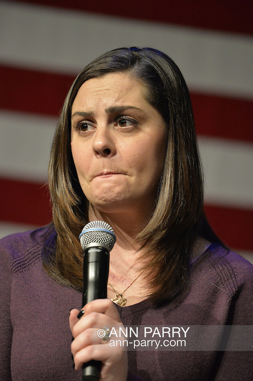 Port Washington, New York, USA. April 11, 2016. ERICA SMEGIELSKI, who lost her mother Dawn Lafferty Hochsprungand, the Principal of Sandy Hook Elementary School in Newtown, CT, has sorrowful expression with pursed lips as she shares her personal story of loss of a loved one due to gun violence, during a discussion with Hillary Clinton and other activists on gun violence prevention. HILLARY CLINTON, the leading Democratic presidential primary candidate, called for stricter gun control legislation. Clinton had several Long Island events scheduled this day, and the New York presidential primary is April 19.