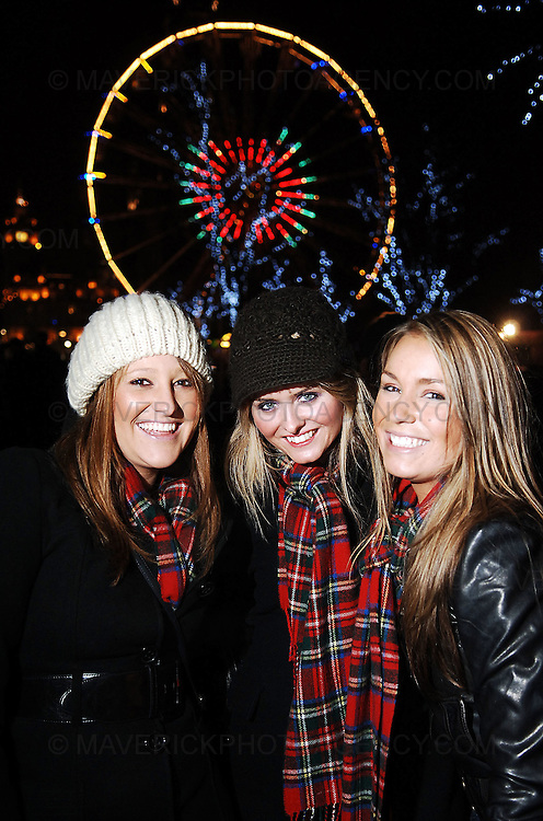 EDINBURGH, UK. Early revellers hit Princes Street in Edinburgh leading up to the bells at midnight...Pic shows from left Amanda Gow, Alannah Ward and Rebecca Marjoram all from Australia here for the hogmanay celebrations...Picture Richard Scott/Maverick
