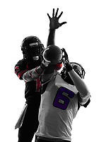 two american football players pass action in silhouette shadow on white background
