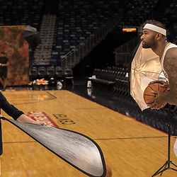 Sep 25, 2017; New Orleans, LA, USA; Kathy Anderson with the associated press uses a reflector as New Orleans Pelicans center DeMarcus Cousins (0) poses for a portrait during Media Day at the Smoothie King Center. Mandatory Credit: Derick E. Hingle-USA TODAY Sports