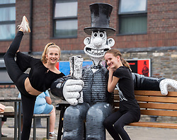 "© Licensed to London News Pictures.  01/07/2018; Bristol, UK. Gromit Unleashed 2. Chantelle Watson and Miriam Curzon both aged 13 (verbal permission given for photo) pose with the ""Wallambard"" Wallace character (after Isambard Kingdom Brunel) installed outside the SS Great Britain at Bristol Harbourside for the Gromit Unleashed 2 sculpture trail. Gromit Unleashed 2 which officially begins on 02 July will see the Academy Award®-winning character Gromit by Nick Park at Aardman Animations returning to Bristol in 2018 for the second time on sculpture trails to raise money for  the Grand Appeal charity. The character of Gromit will be joined by Wallace and their arch nemesis Feathers McGraw. The trail will feature over 60 giant sculptures designed by high-profile artists, designers, innovators and local talent. Sculptures will be positioned in high footfall and iconic locations around Bristol and the surrounding area. Photo credit: Simon Chapman/LNP"