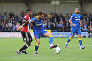 AFC Wimbledon defender Callum Kennedy (23) battles for possession with Brentford midfielder Josh Clarke (20) during the EFL Cup match between AFC Wimbledon and Brentford at the Cherry Red Records Stadium, Kingston, England on 8 August 2017. Photo by Matthew Redman.