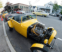 Hot Rods, classics and antique cars lined Main Street following the Cruise Night Parade through Meredith Saturday evening.  (Karen Bobotas/for the Laconia Daily Sun)