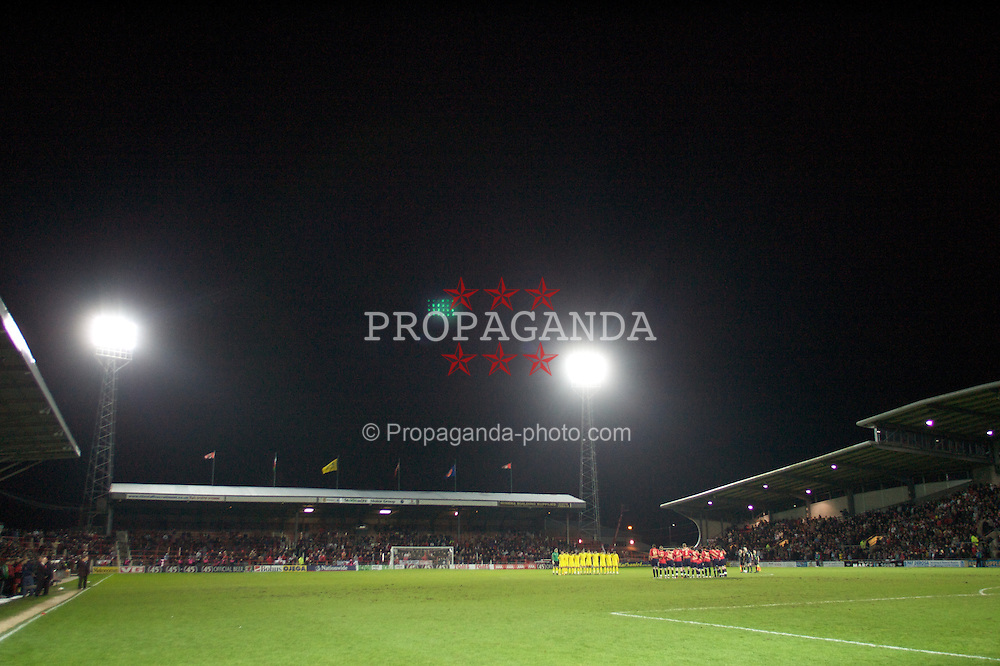 WREXHAM, WALES - Wednesday, February 6, 2008: Wales' players stand for a minute's silence to remember the 50th anniversary of the Munich air crash before the international friendly match against Norway at the Racecourse Ground. (Photo by David Rawcliffe/Propaganda)