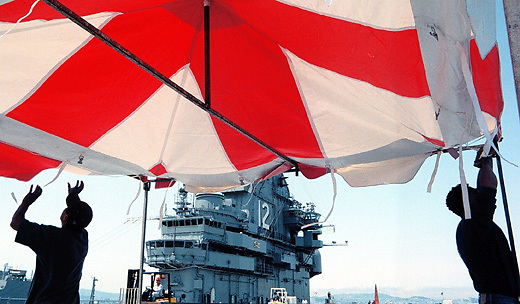 Hasain Rasheed STAFF 7/2/02 Tribune News..Workers set up a canopy aboard the U.S.S. Hornet at the former Alameda Naval Air Station Tuesday in preparation for Fourth of July festivities.Erica and Dan Wedding.March 3, 2007.Hasain Rasheed Photography 2007