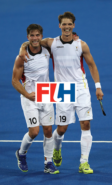 RIO DE JANEIRO, BRAZIL - AUGUST 16:  Cedric Charlier (L) of Belgium celebrates their 3-1 victory with team mate Felix Denayer during the Men's semi final hockey match between Belgium and the Netherlands on Day 11 of the Rio 2016 Olympic Games held at the Olympic Hockey Centre on August 16, 2016 in Rio de Janeiro, Brazil.  (Photo by David Rogers/Getty Images)