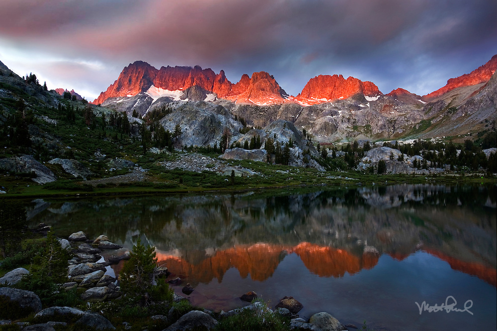 This was taken at Lake Ediza, one of the most spectacular alpines lakes in the Sierras. It was 5:30 AM when I heard Josh yelling there were clouds. I jumped out of my tent into the cold, grabbing my camera gear, rushed to the other side of the lake, waiting for the show to begin, as the light illuminated the Minarets.