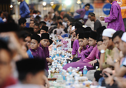 Image ©Licensed to i-Images Picture Agency. 29/06/2014. Kuala Lumpur, Malaysia. Young Malaysian Muslim children waiting before breaking their fast on the first day of the holy fasting month of Ramadan. Picture by Mohd FIrdaus / i-Images