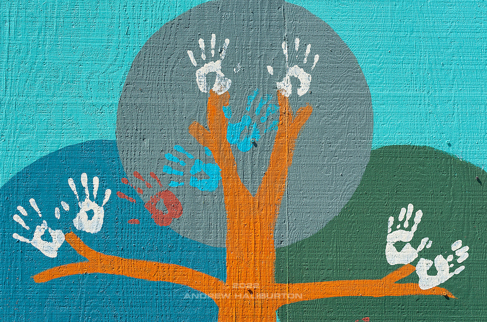 Wall Art. Hands of volunteers at a work meet.  Café au Play at Tabor Commons, a project of the Southeast Uplift Neighborhood Coalition (SEUL) and volunteers from Portland's Mt Tabor neighborhood.