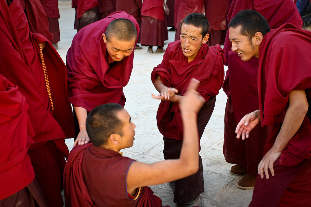 Tibetan Buddhist monks debating (Sakya, Tibet).