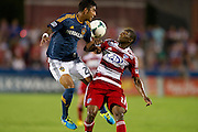 FRISCO, TX - AUGUST 11:  A.J. DeLaGarza #20 of the Los Angeles Galaxy fights for the ball with Fabian Castillo #11 of FC Dallas on August 11, 2013 at FC Dallas Stadium in Frisco, Texas.  (Photo by Cooper Neill/Getty Images) *** Local Caption *** A.J. DeLaGarza; Fabian Castillo