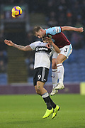 3 Charlie Taylor for Burnley FC challenges Fulham striker Aleksandar Mitrovic (9) during the Premier League match between Burnley and Fulham at Turf Moor, Burnley, England on 12 January 2019.