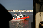 The U.S. Coast guard patrols the Potomac River as a part of security measures taken for the Presidential Inauguration ceremonies in Washington, D.C., on January 21, 2013.