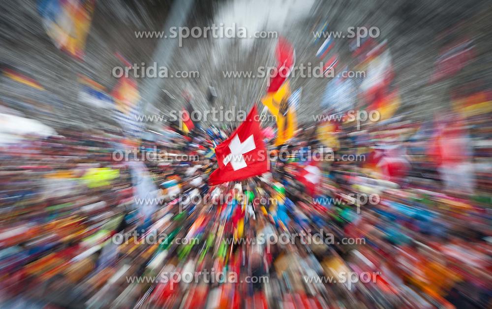 "20.01.2012, Südtirol Arena, Antholz, ITA, E.ON IBU Weltcup, 6. Biathlon, Antholz, Sprint Herren, im Bild Fan Feature, Zoomeffekt in der Mitte die Schweizer Flagge // Fan Feature Zoom Effect in the middle the Flag of Switzerland during Sprint Men E.ON IBU World Cup 6th, ""Southtyrol Arena"", Antholz-Anterselva, Italy on 2012/01/20, EXPA Pictures © 2012, PhotoCredit: EXPA/ Juergen Feichter"