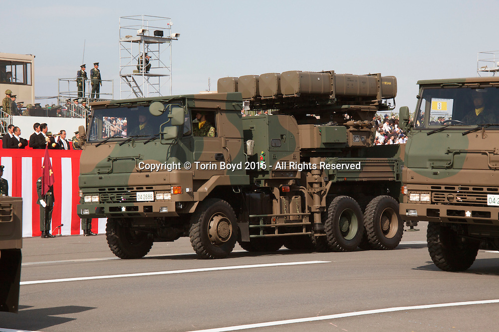 October, 23, 2016, Asaka, Saitama Prefecture, Japan: Missile defense units including Patriot and SAM missile systems parade their hardware during an annual military review held at the Asaka Training Area, a JSDF base on the outskirts of Tokyo. These units have become ever so important now that North Korea has been developing long range missile capabilities and threatening Japan. During this event, Prime Minister Shinzo Abe, top ranking Japanese military brass and international dignitaries were in attendance to view Japan's military might. This included 4000 troops, 27 divisions, 280 vehicles and artillery, plus 50 aircraft of the Ground, Air, and Maritime branches of the JSDF. (Torin Boyd/Polaris).