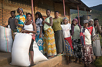 Women come to drop off freshly picked coffee cherries at Nyarusiza Washing Station in southern Rwanda. Maraba town, near Nyarusiza, is one of Rwanda's coffee boom towns which has seen powerful economic growth as a result of specialty coffee price premiums.