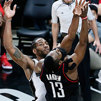 01 May 2017: Houston Rockets guard James Harden (13) is fouled by San Antonio Spurs forward Kawhi Leonard (2) during the Houston Rockets 126-99 victory over the San Antonio Spurs, in game 1 of the Western Conference Semi Finals, at the AT&T Center, San Antonio, Texas, USA.
