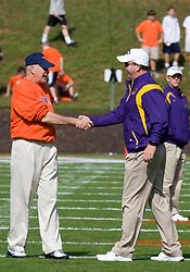 Virginia head coach Al Groh and ECU head coach Skip Holtz meet before the game.  The Virginia Cavaliers defeated the East Carolina Pirates 35-20 in NCAA football at Scott Stadium on the Grounds of the University of Virginia in Charlottesville, VA on October 11, 2008.