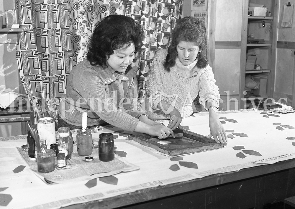 R3011<br /> National College of Art Kildare Street, two women Screen printing and stencilling.Names unknown. <br /> 10 May 1962.<br /> (Part of the Independent Ireland Newspapers/NLI Collection)