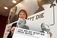 07.01.1999, Deutschland/Bonn:<br /> Angela Merkel, CDU Generalsekret&auml;rin, mit einem Plakat &quot; und wo ist jetzt die neue Mitte?&quot;, nach einer Pressekonferenz, Konrad-Adenauer-Haus, Bonn<br /> IMAGE: 19990107-01/01-36<br /> KEYWORDS: Plakat, bill, Werbung, promotion