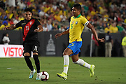 Brazil midfielder Casemiro (5) is defended by Peru forward Raul Ruidiaz (11) during an international friendly soccer match, Tuesday, Sept. 10, 2019, in Los Angeles. Peru defeated Brazil 1-0.